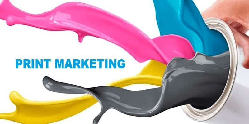 Colored Ink Splashing Out of Bucket With Words Print Marketing