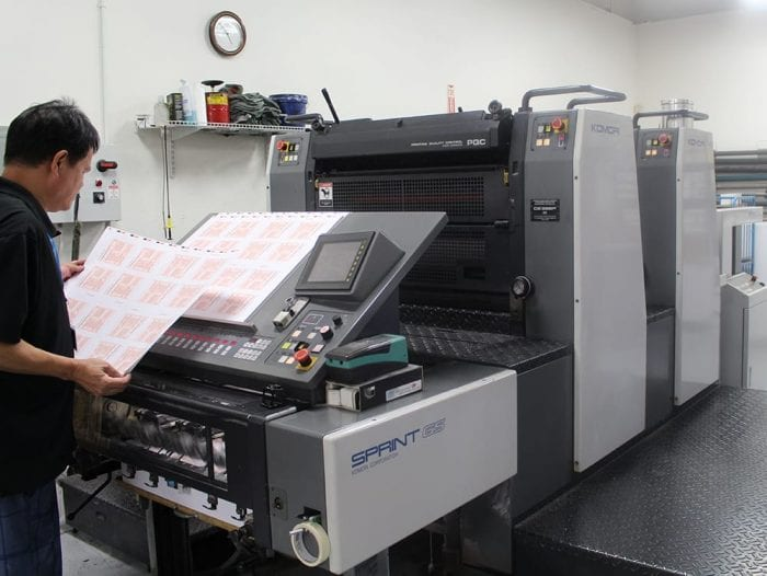 production team on komori press