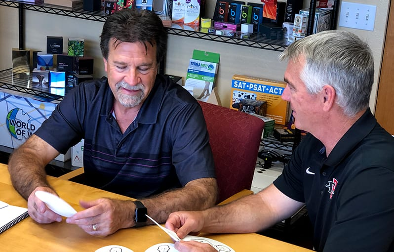 Jerry Wissing and Customer Discussing Optinos